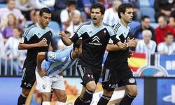 Álex López celebra uno de los tantos del Celta ante el Málaga.   EFE