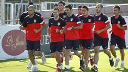 Los jugadores del Atlético de Madrid realizan carrera contínua. | EFE