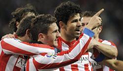 Los jugadores del Atlético celebran el segundo gol, obra de Koke. | EFE