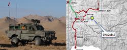 Vehículo blindado de pelotón RG31y mapa de la zona de la operación.   Mde