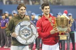 Novak Djokovic y Rafael Nadal, después de la final | Efe