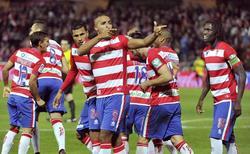 El Arabi celebra uno de sus tres goles al Málaga en el derbi. | EFE
