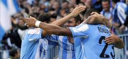 Los jugadores del Málaga celebran el único tanto del partido. | EFE