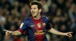 Messi celebra su primer gol al Zaragoza. | EFE