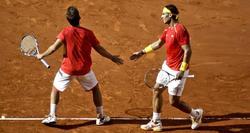 Nadal y López, durante el partido de dobles. | EFE