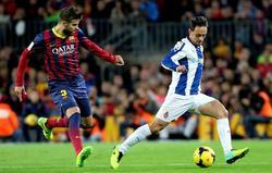 Piqué y Sergio García, durante el derbi catalán. | EFE