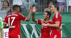 Thiago (c) celebra con Boateng y Van Buyten su gol al Borussia Mönchengladbach. | EFE