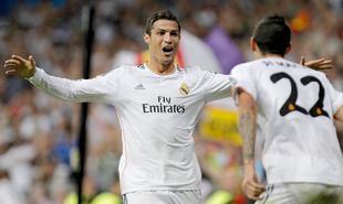Cristiano celebra uno de sus dos goles con Di María. | Cordon Press