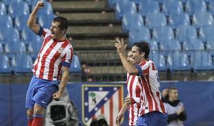 Emre celebra el segundo tanto del Atlético, una obra de arte. | EFE