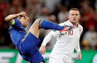Rooney ante Tymoshchuk. | EFE