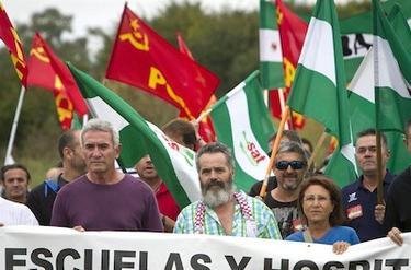 Diego Cañamero (i) junto a Sánchez Gordillo(d) durante una manifestación del SAT | EFE