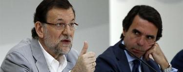 Mariano Rajoy, junto a José María Aznar, este domingo en el Campus FAES | EFE