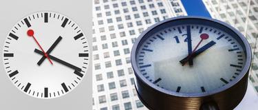 El reloj de Apple junto al reloj de Canary Wharf, Londres, siguiendo el modelo suizo. | Apple y Corbis