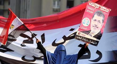 Una seguidora de Mursi celebra su victoria. | EFE