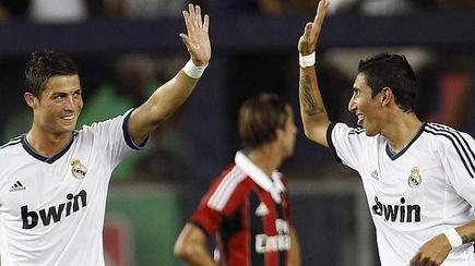 Di María celebra un tanto ante el Milan junto a Cristiano Ronaldo. | EFE