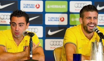 Xavi y Piqué son serias dudas para la Supercopa.   Archivo