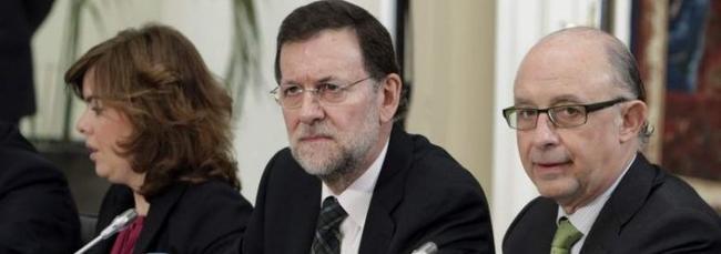 Rajoy, con Sáenz de Santamaría y Montoro, que también estarán este lunes en Génova13.